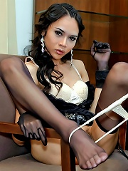 Ladyboy wanks with a heel in...