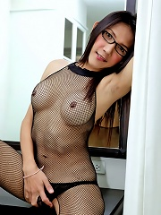 Ladyboy in glasses with huge...