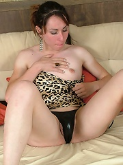 Brunette shemale pours stick...